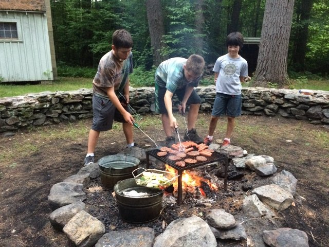 Cooking meals over a wood fire during Summer camp at BBA (640x480)
